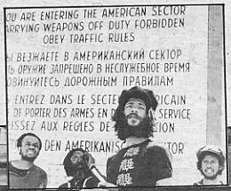 Steel Pulse take a look at Checkpoint Charlie in Berlin [photo NME]