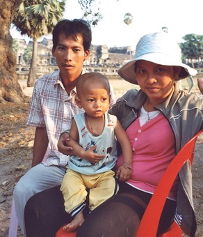 Noung, her baby and husband at Angkor Wat.