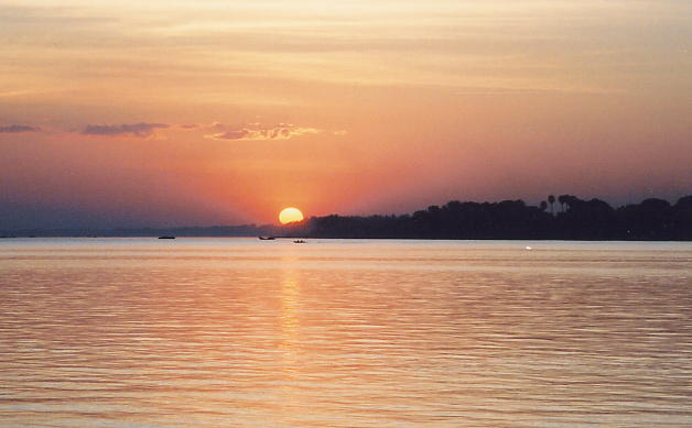 The setting sun from the east bank of the Mekong River looking across to Kompong Cham.