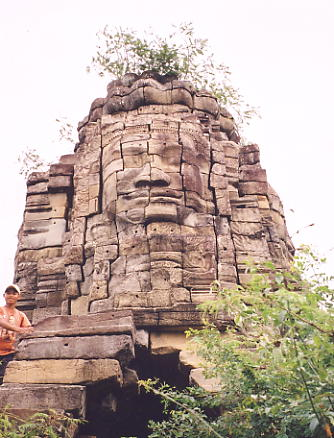 A Bayon-style face at Ta Prohm, near the main Banteay Chhmar complex.