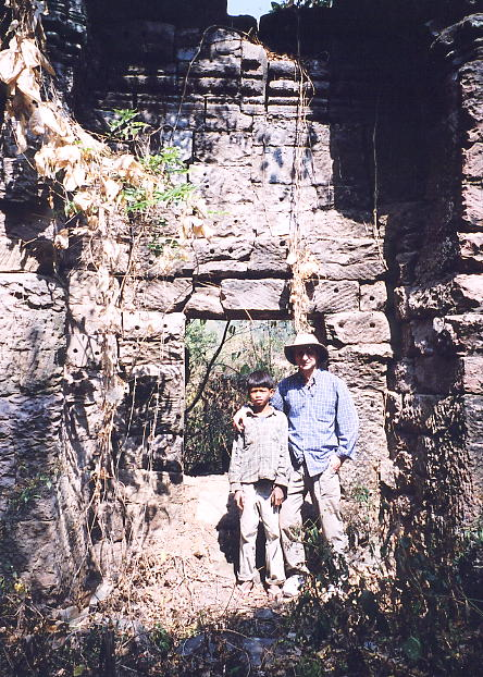 The author (with silly hat) and our 15 year old guide Sita at Prasat Yeay Pum, Banteay Chhmar.