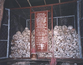 Victims of the Khmer Rouge in a cave shrine on Phnom Sampeou, Battambang.