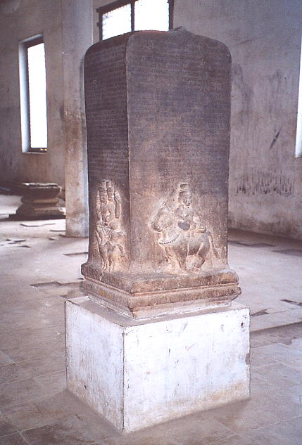 A large boundary stone with inscription and carved figures at Wat Po Veal.