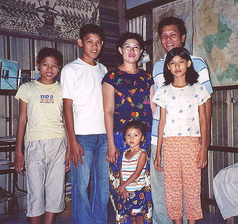 Sak and his adorable family at their home in Battambang.