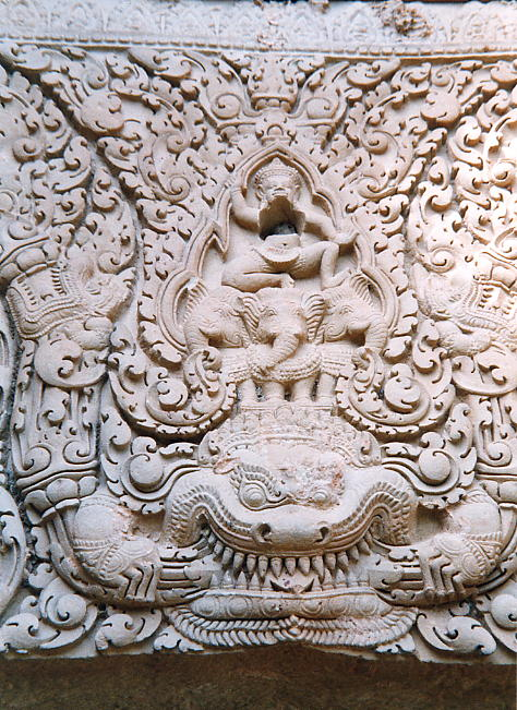 The fine detail of the temple's remaining lintel showing Indra riding Airavata atop a devouring Kala.