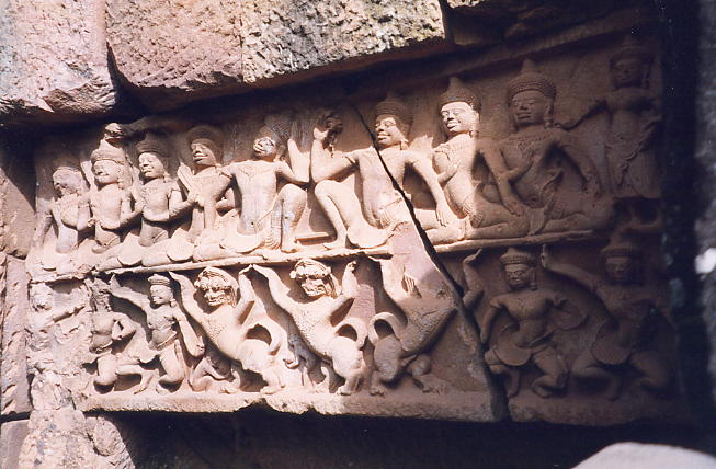 The south lintel of Wat Snoeung West showing a gambling scene from the Mahabarata, with lions and female dancers on the lower level.