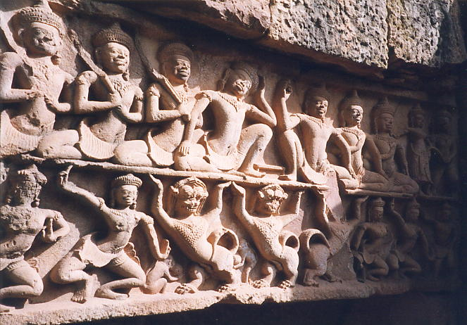 The top level of this lintel shows the sons of Pandava losing the beautiful Draypadi as a wager during a dice game. In the centre, a prideful Sakuni holds the loaded dice aloft while a downcast Yudhisthira and his 4 brothers look on.