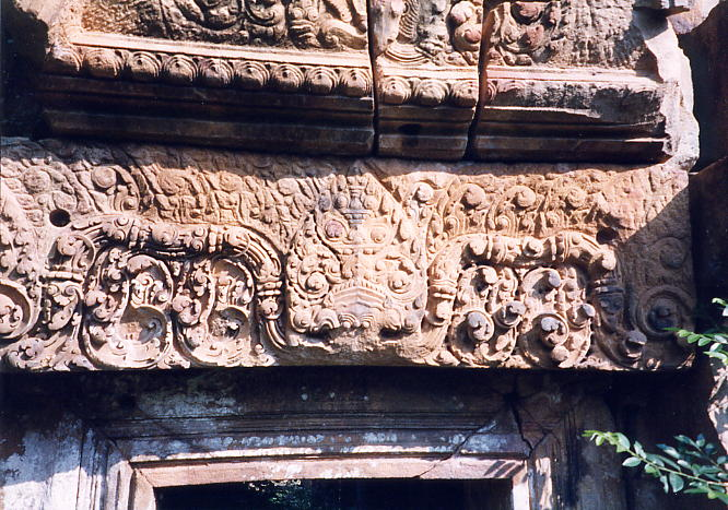 This well carved lintel has a vandalized fronton above it. I'm still not sure why some lintels are painted and others are not.