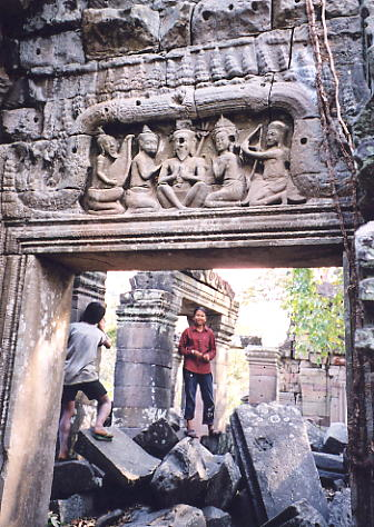A frieze of hermits (Rishis) above a doorway, with India in the background.