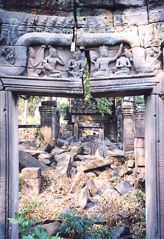 A doorway with a split carving looking into the jumbled interior of the temple.