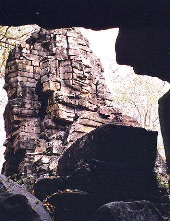 Looking between the ruins of a fallen tower towards another face tower.