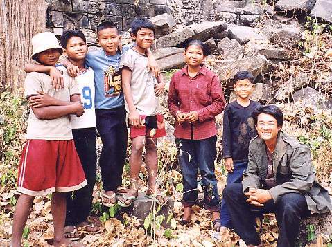 Heang (right) and our welcoming committee at Banteay Chhmar. Their leader was India, in the red shirt.