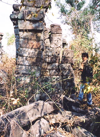 Heang inspects a wall at Prasat Mebon.