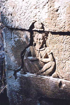 A good quality carving of a hermit at Prasat Mebon.