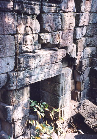 Next to this doorway at Prasat Yeay Pum, an apsara had been cut out of the wall.