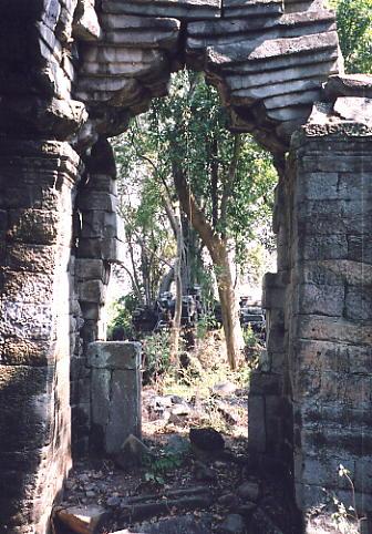 An archway at the forest-clad Prasat Chegnchemtrei.