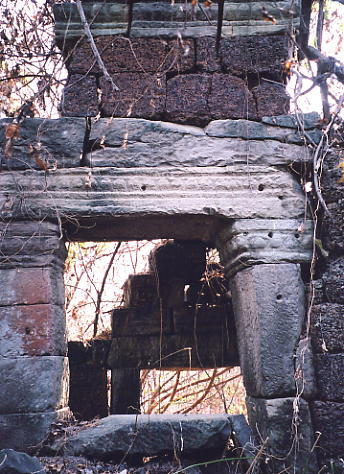A window and wall are the only remains of Prasat Yeay Chor.