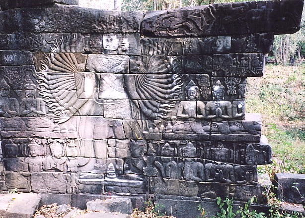 The broken wall showing the Lokesvara bas relief. Thieves left two out of an original eight Lokesvaras in situ.