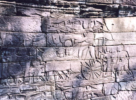 A bas relief showing the King leading his troops into battle.