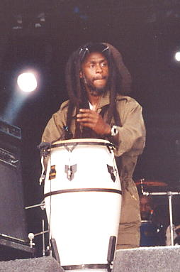 David Hinds plays an electronic conga drum in rehearsals.