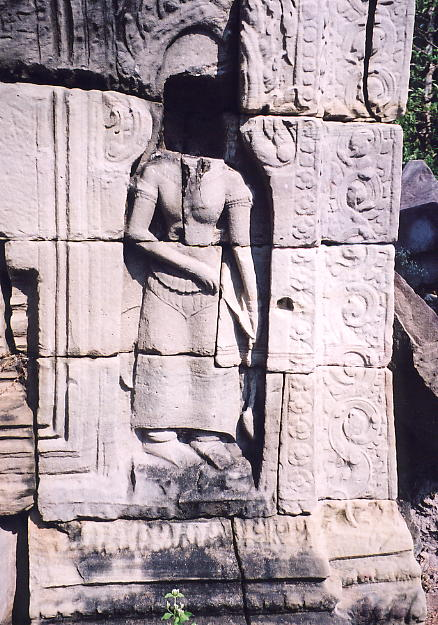The first obvious sign of looting at Banteay Thom is this Devata with her head removed.