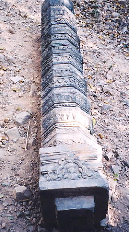 A decorative colonette lying on the ground at Prasat Trav.