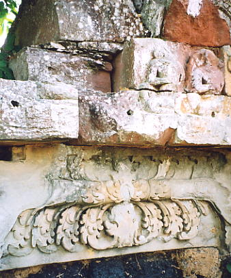 A partially defaced lintel and carving at Prasat Takom near Koul village.