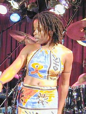 Donna on stage with Steel Pulse [photo courtesy of HIM reggae photos]