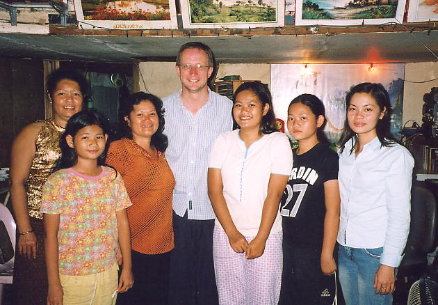 The author surrounded by a bevy of beauties, in Tuol Kauk.