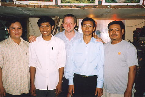 The author and the menfolk line up for the camera, in Tuol Kauk.