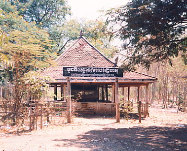The wooden genocide memorial at the foot of Phnom Oudong.
