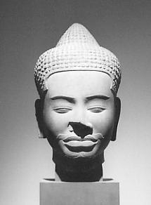 Buddha head from Ta Prohm, 11th century, Guimet Museum, Paris.