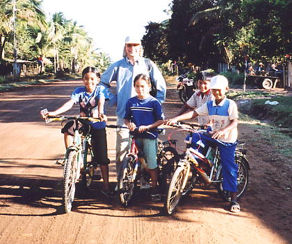 Andy and new friends in Samrong, Cambodia - December 2003.