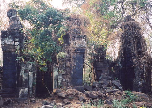 Two of the three massive laterite towers at Prasat Chen.