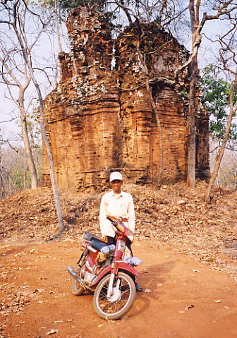 Sokhom, his trusty Daelim and Prasat Kraham, surrounded by landmine signs.