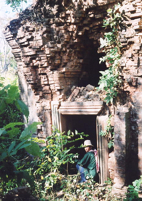 One of the brick sanctuaries in the southwest corner of the inner enclosure, with Sokhom taking a rest.