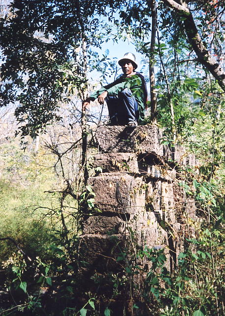 Sokhom perched precariously on the remains of a laterite gallery.