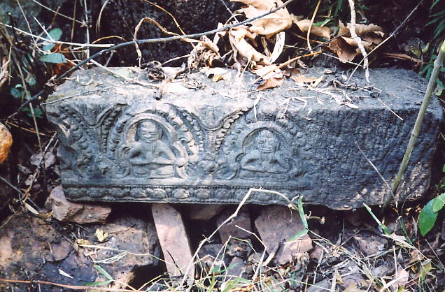 A carving we recovered from the undergrowth showing ascetics in meditation.