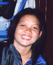 Noung and her beaming smile, at home, January 2003.