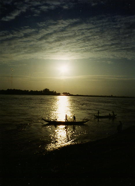 Sunrise over the Tonle Sap river and early morning fishermen at work.