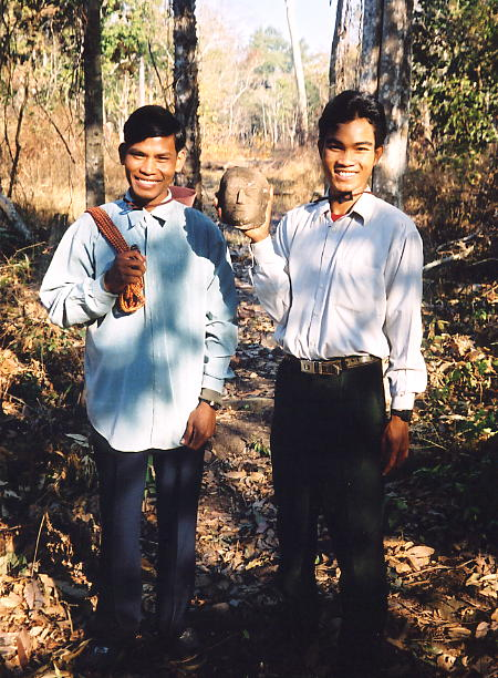 Paon and Vanna, holding a carved head, at Preah Khan.