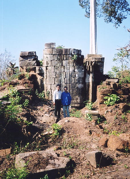 Paon and Sokhom stand in front of Preah Ang Thom, the site of a massive standing Buddha, now damaged.