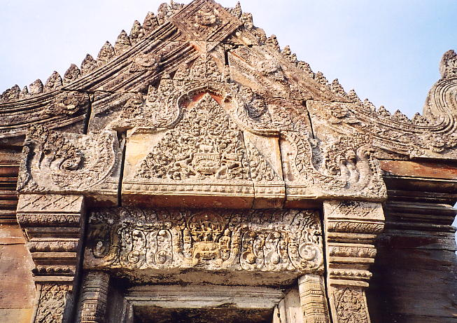 A finely-detailed pediment and lintel, bathed in sunlight, at Preah Vihear.