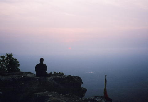 Scott waits for the sunrise at Preah Vihear, a little after 6am.