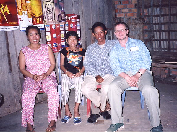 My favourite Kompong Thom family: LtoR - Sroy, Kunthea, Sokhom and the author, relaxing outside their home.