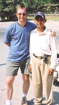 The author (with bow legs) and Ran outside the Royal Palace in Phnom Penh.