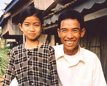 Sokhom in typical smiling mode, with his adorable daughter, Kunthea.