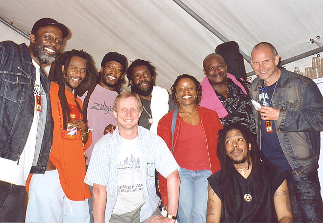 Steel Pulse in Eindhoven, August 2003. LtoR: Selwyn Brown, David Hinds, Conrad Kelly, Sidney Mills, Donna Sterling, Alvin Ewen, Richard Hermitage (manager): Andy Brouwer, Moonie Pusey.