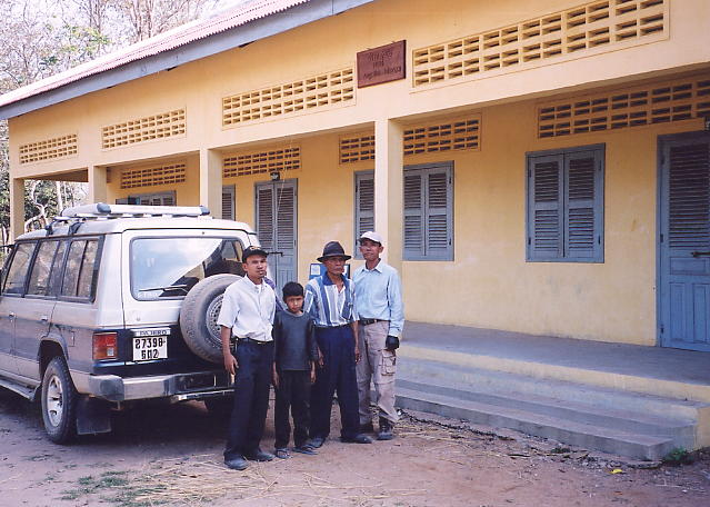 A school building donated by Angelina Jolie is the backdrop for this team photo. LtoR: Rieng, Riay, Tomrin and Heng.