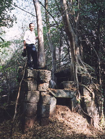 Rieng poses on top of one of the ruined towers at Prasat Kranung.